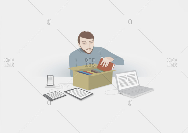 Man packing books into a box connected to digital devices