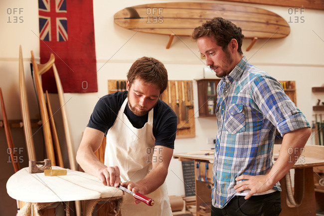 Craftsmen sharing woodworking techniques