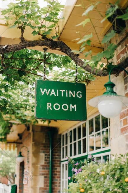 Waiting room sign at vintage train station