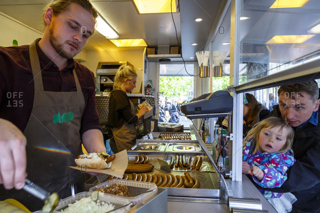Copenhagen, Denmark - May 3, 2014: Customers at DOP, an organic hotdog stand