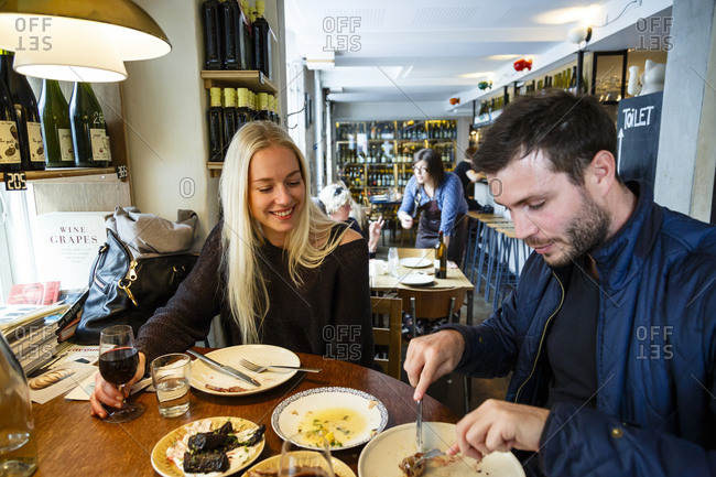 Copenhagen, Denmark - May 2, 2014: Couple dining at Manfreds and Vin restaurant