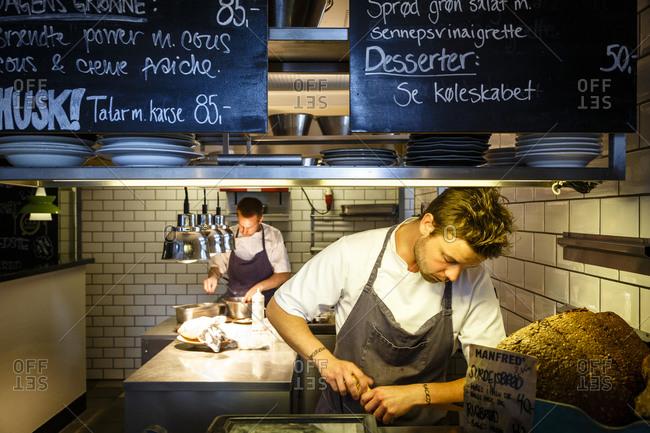 Copenhagen, Denmark - May 2, 2014: Chefs working at Manfreds and Vin restaurant