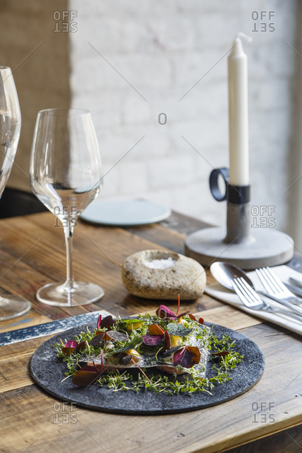 Veal tartare, lumpfish roe, lobster mayonnaise, kohlrabi, cress and powder of burned onions dish at Host restaurant