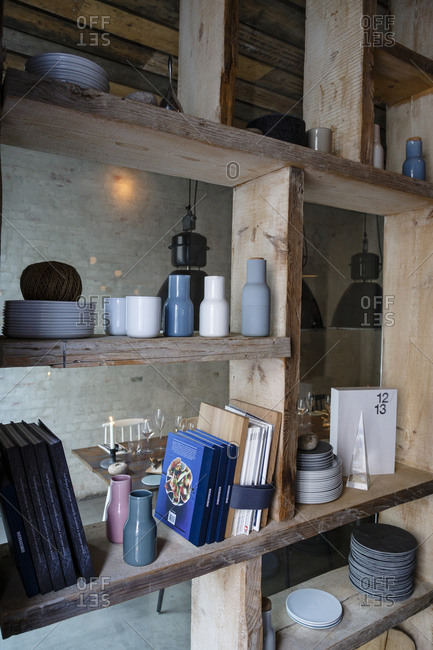 Copenhagen, Denmark - April 30, 2014: Shelves and dishes inside Host restaurant