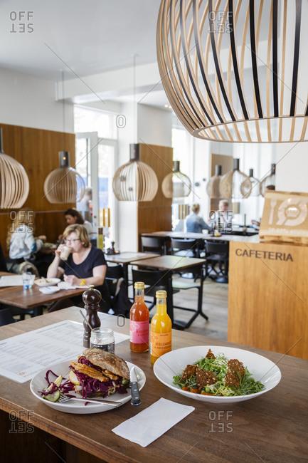 Copenhagen, Denmark - April 30, 2014: Warm pork sandwich and salmon salad inside Meyer's Deli