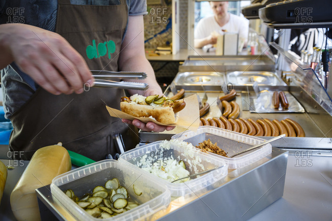 Copenhagen, Denmark - April 29, 2014: Making hotdogs at DOP, an organic hotdog stand