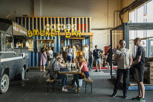 Copenhagen, Denmark - July 1, 2015: Diners at the Copenhagen Street Food located at Papiroen