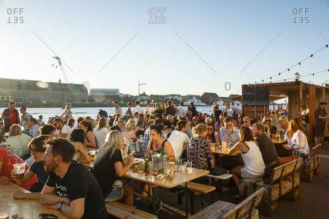 Copenhagen, Denmark - July 1, 2015: People eating at the Copenhagen Street Food located at Papiroen