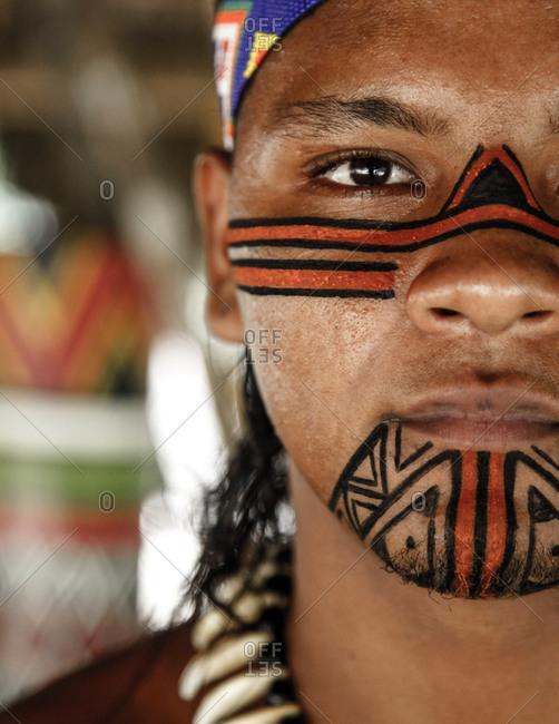 Bahia, Brazil -  March 16, 2010: Portrait of a Pataxo Indian man at the Reserva Indigena da Jaqueira near Porto Seguro