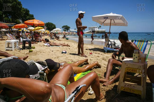 Salvador, Bahia, Brazil - March 14, 2010: Sun worshippers at Porto da Barra beach