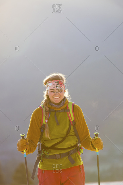 Woman holding ski poles and smiling