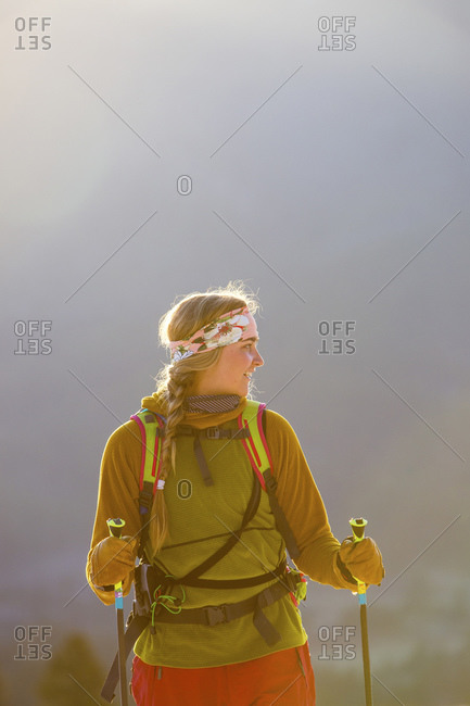 Woman holding ski poles on a mountain