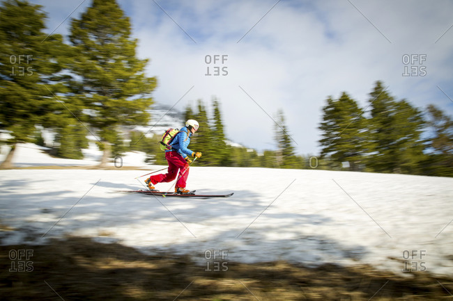 Female skier in motion on a mountainside