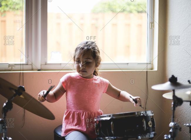 Girl playing a drum set