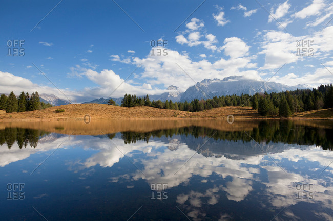 Mountains reflecting in lake, Bavaria, Germany
