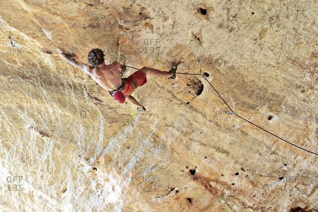 Man rock climbing in Italy