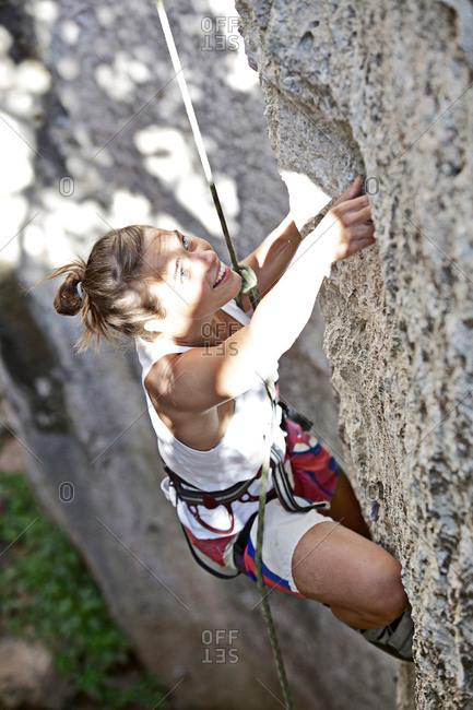Woman rock climbing in Italy