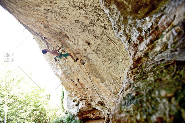 Man climbing rock face in Italy