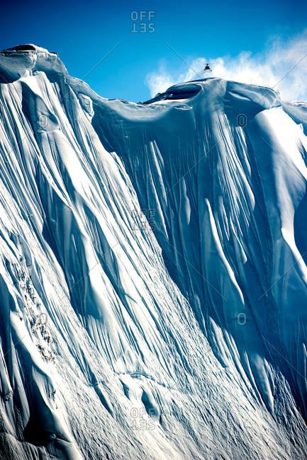 Sheer snowy mountain face in Alaska