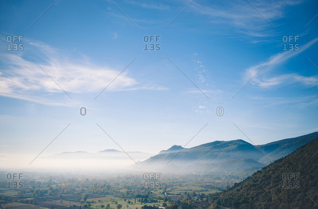 Fog covered mountains and small rural homes