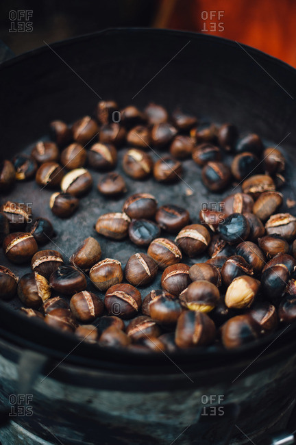 Close up of chestnuts being roasted