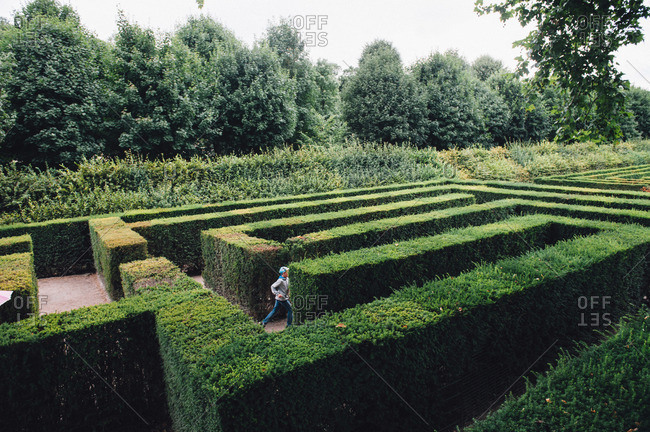 Boy running through Maze & Labyrinth Schonbrunn in Vienna, Austria