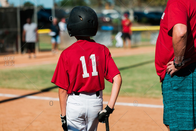 Little boy baseball player in a game
