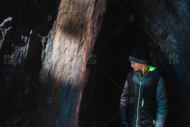 Boy gazing at a rock face