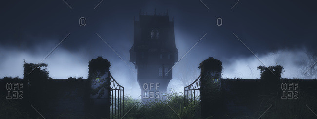 Mysterious house with gate in mist at night