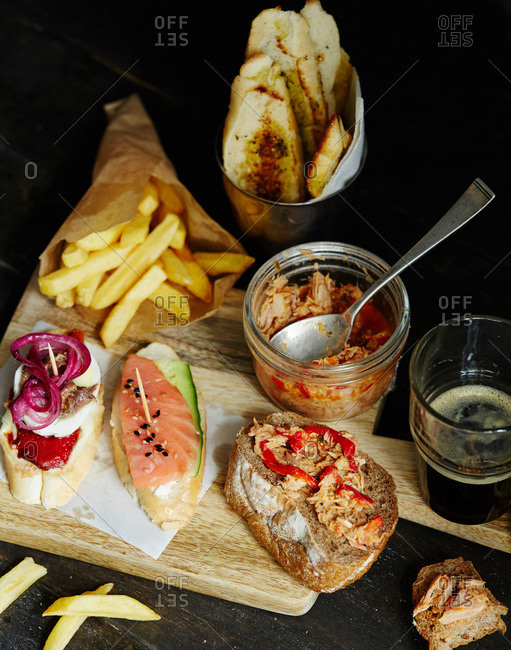 Spanish tapas with anchovies, tuna, salmon on wood board