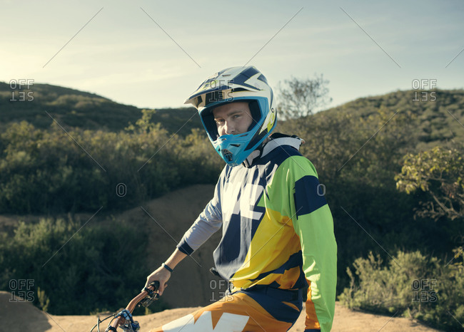 Portrait of a mountain bike free rider with helmet