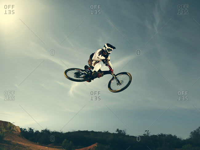 Mountain bike free rider soaring in the air