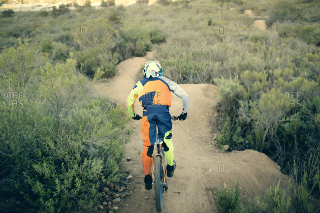 Mountain bike rider on a dirt trail