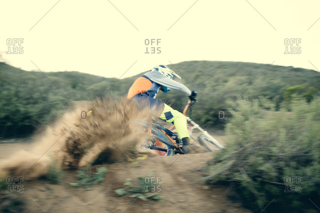 Mountain bike rider spinning out in dirt