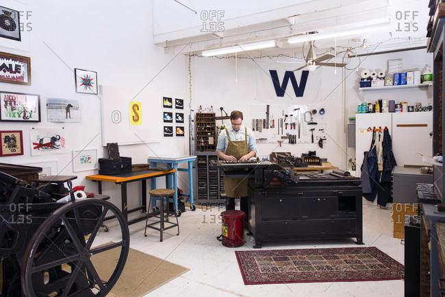 Man working in a letterpress workshop