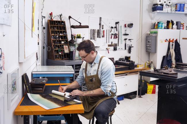 Printmaker working in a letterpress workshop