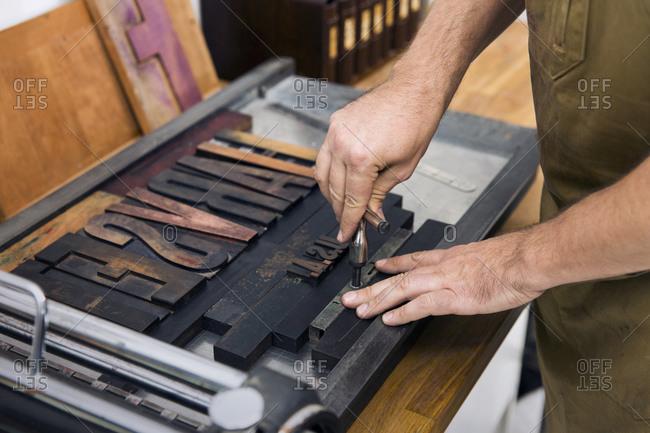 Man setting type in a letterpress studio