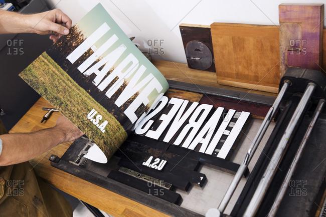 Taking print off of letterpress printing press