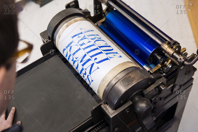 Print coming out of letterpress printing press