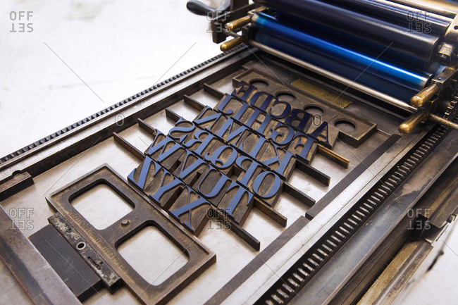 Letterpress type in an inked printing press