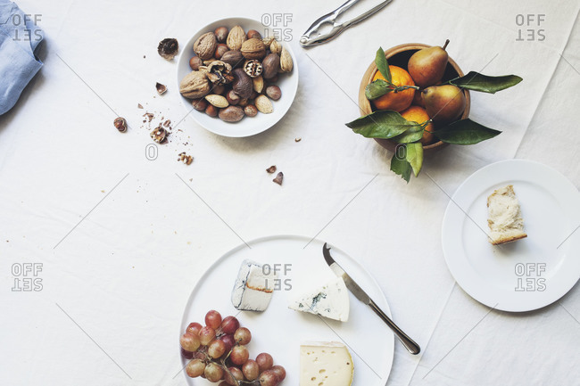 Hors d'oeuvres table with nuts, cheese, bread and grapes