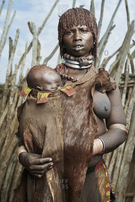 February 13, 2015: Portrait of Hamar woman holding a sleeping infant