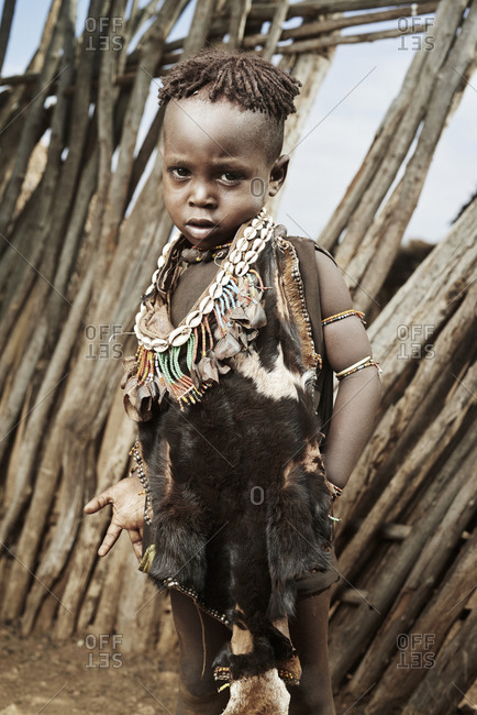 February 13, 2015: Portrait of Hamar child with shell necklace and animal hide garment