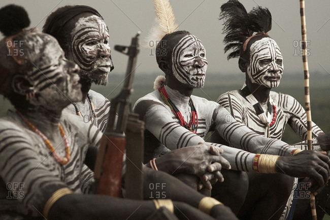 February 14, 2015: Four Karo tribesman with white paint markings on their faces and bodies