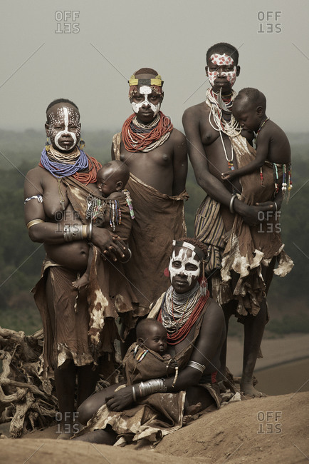 February 14, 2015: Portrait of four Karo women with painted faces and their infants