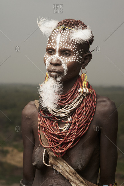 February 14, 2015: Portrait of a Karo woman  adorned with beads, feathers and face paint