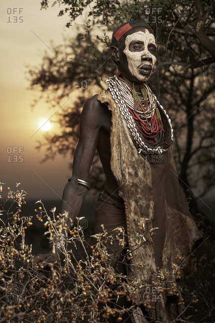 February 14, 2015: Portrait of a Karo tribesman wearing beads and face paint