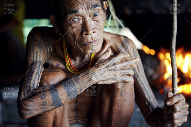November 17, 2013: Portrait of an elderly Mentawai man with a cataract in his eye