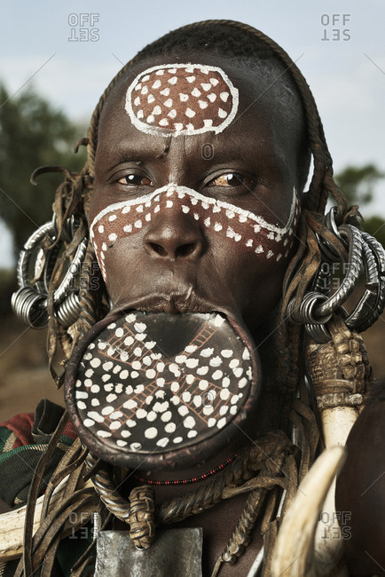 February 19, 2015: Portrait of a Mursi tribesman wearing lip plate and face paint