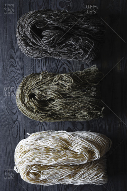 All-natural handspun yarn on dark table